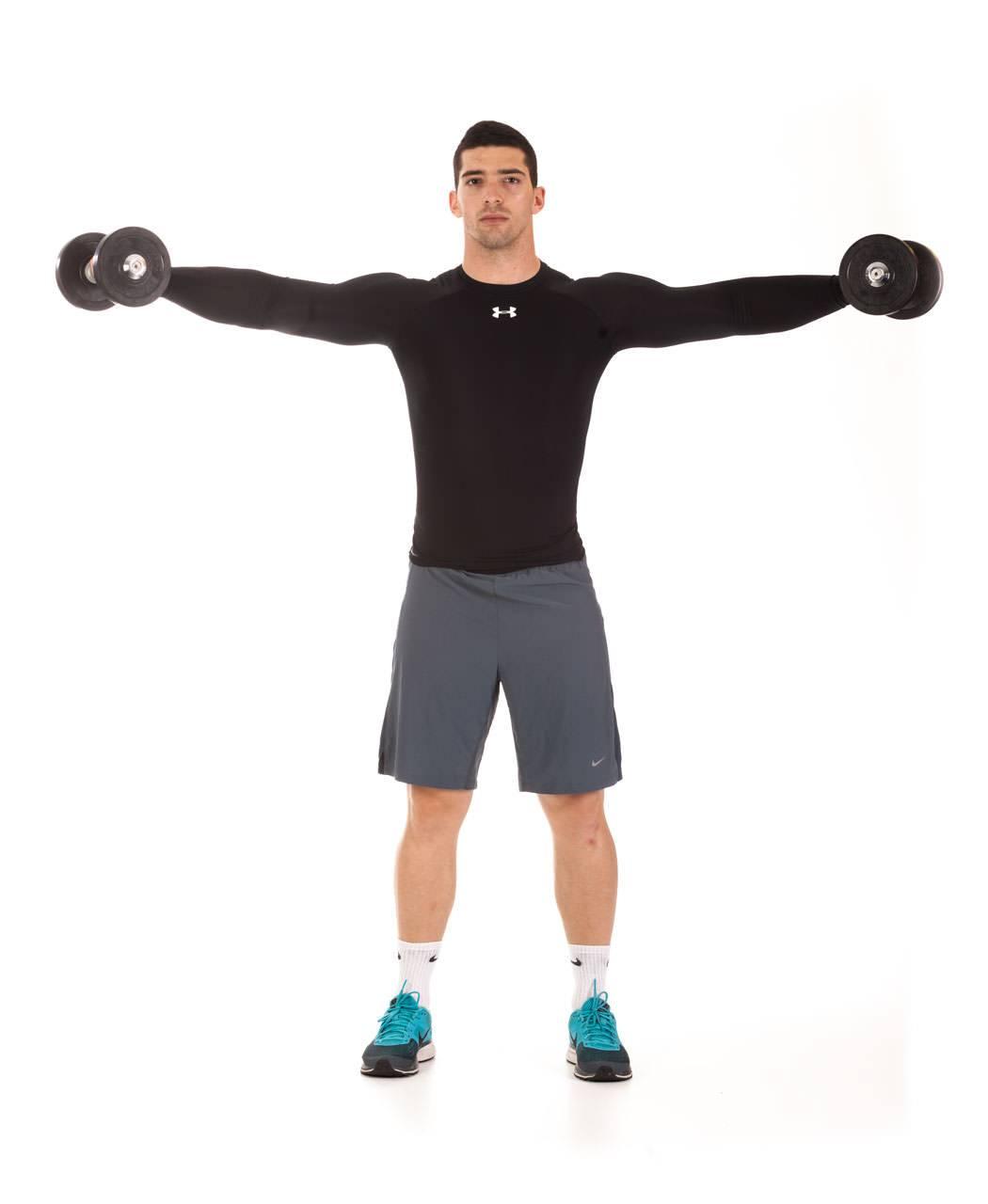 Хочешь широкие плечи? узнай, как правильно делать разведение гантелей стоя!