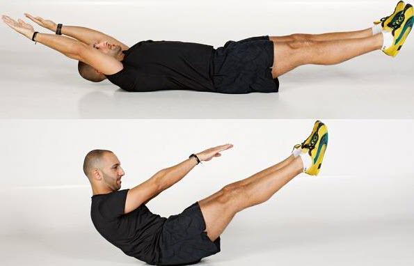 Подъем ног в упоре на локтях
